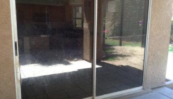 Full view of sliding door before repair.
